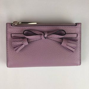 Kate Spade Hayes small wallet orchid tassel